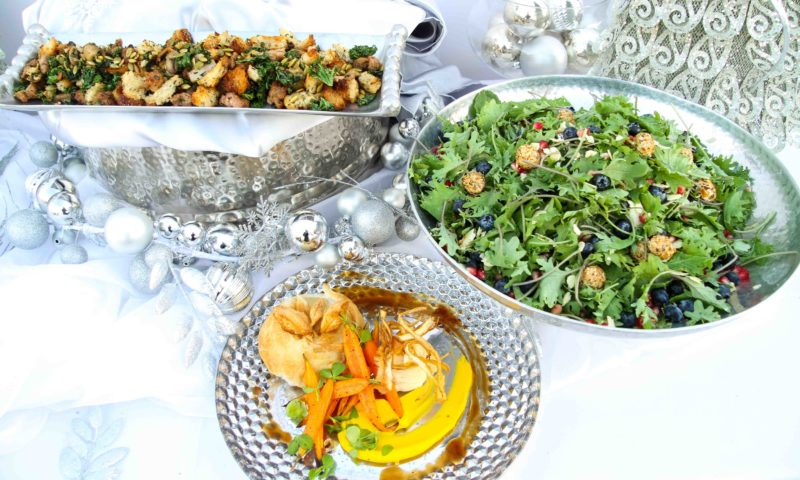 holiday decor around elegant dishes