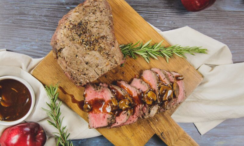 Tri - tip steak served at catering event